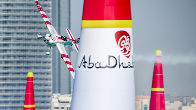 Paul Bonhomme of Great Britain performs during the finals of the first stage of the Red Bull Air Race World Championship in Abu Dhabi, United Arab Emirates on February 14, 2015.